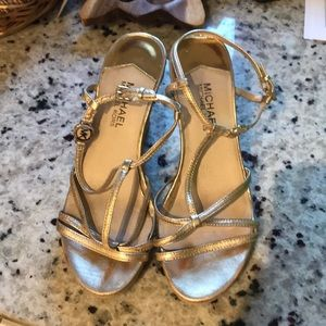 Almost perfect Michael Khors goldwedge sandals 7.5